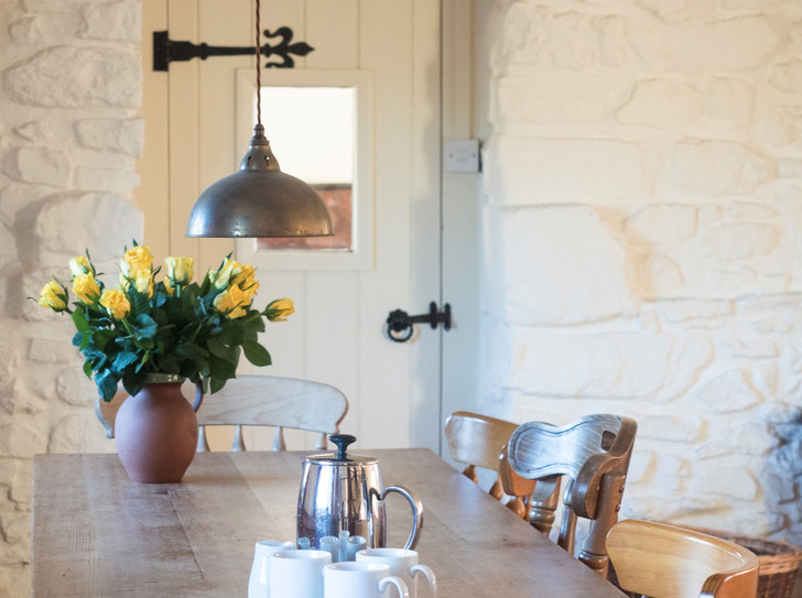 Dining area in Dairy. Self catering for large group holidays in Devon