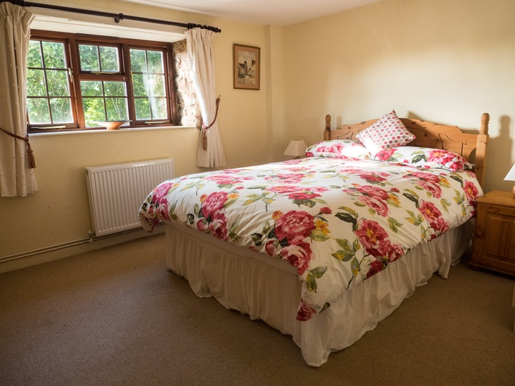 Downstairs double bedroom in Higher Westcott cottage. Self catering holidays for large groups in Devon